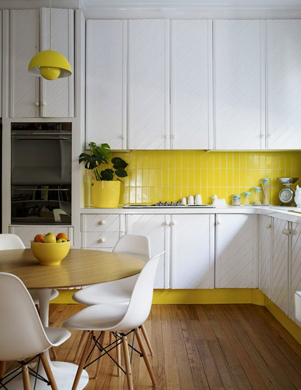 vertical stack bond clad subway tiles in this kitchen add a pop of color