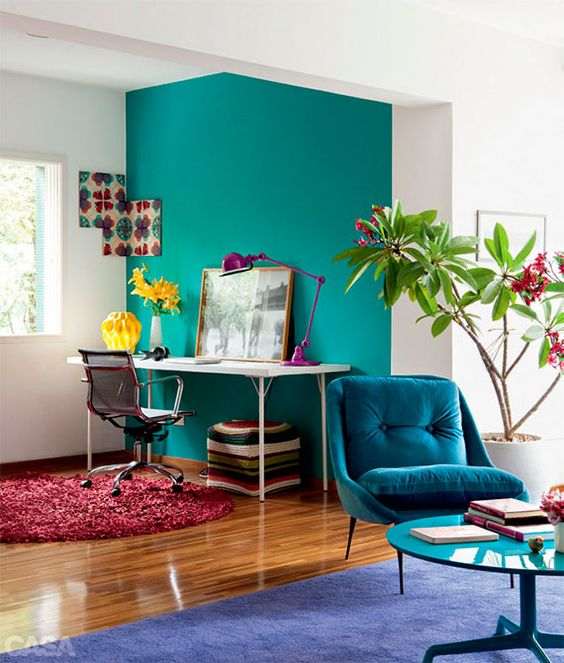 vibrant turquoise wall to highlight and separate the home office nook