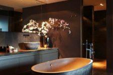 32 spacious dark bathroom, a free-standing bathtub with a textural look