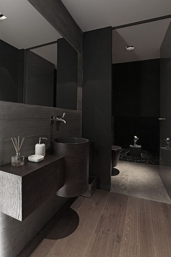 this minimalist bathroom looks cool beacuse of wood and stone textures