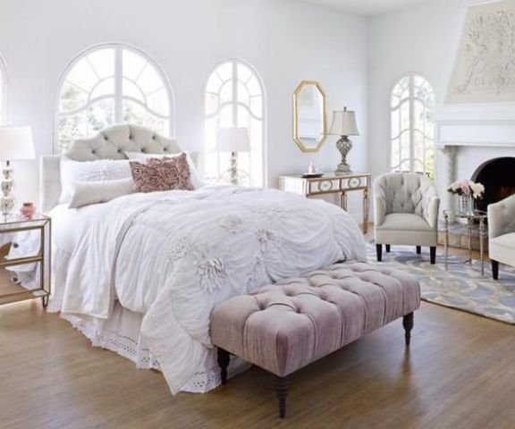 a tufted headboard echoes with a tufted bench