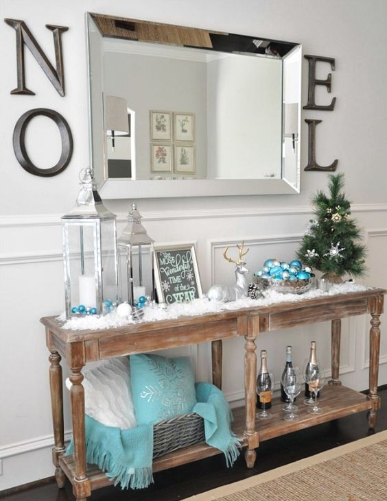light blue ornaments and a pillow with a snowflake