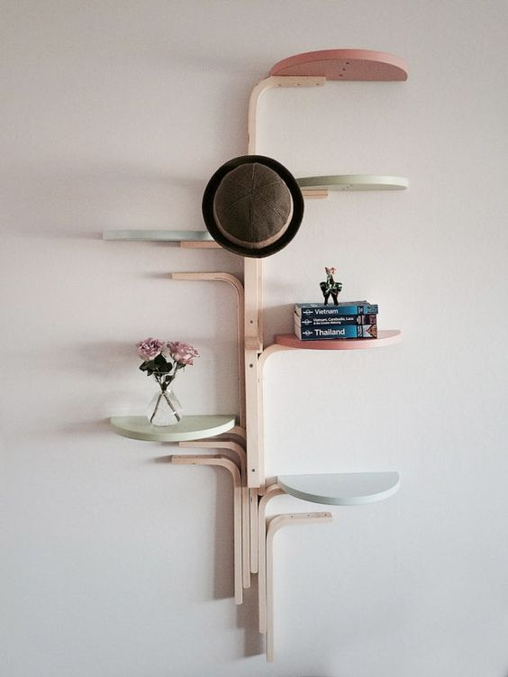 wall-mounted shelf made of several stools and painted in pastel colors