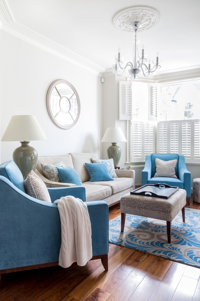 Even such thing as a hardwood floor mixes great with light blue upholstery. (Town House Interiors)