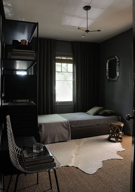 cozy bedroom in black with textural textiles