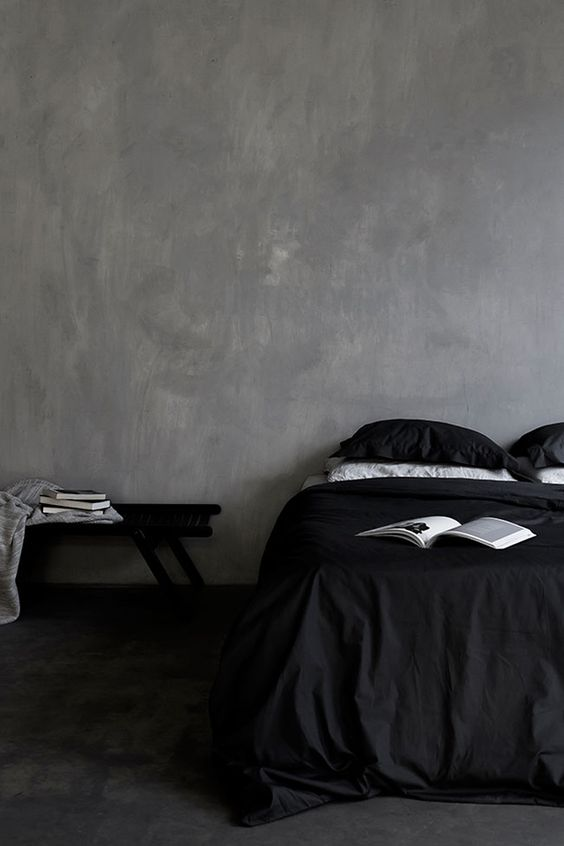 dark alluring bedroom with very simple and minimalist decor