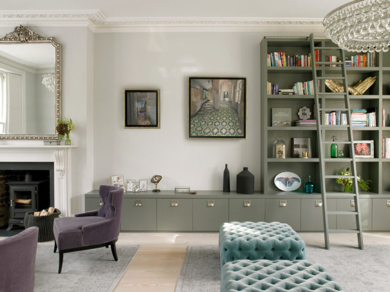 A classic Victorian living room design in shades of gray but with pastel color accents like turquoise ottomans and a olive green storage system. (STEPHEN FLETCHER ARCHITECTS)