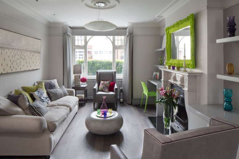 A very neutral gray room with a taupe wallpaper but bright lime pops. (Emma Green Design)