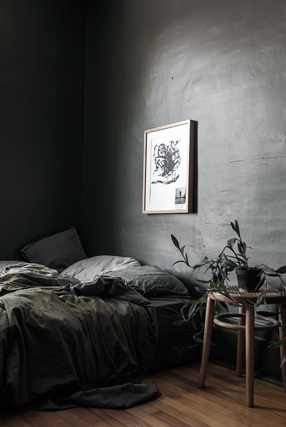 grey moody bedroom with organic decor