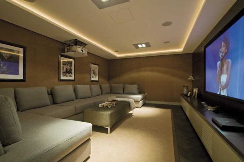 built-in ceiling lighting is a great choice for a home cinema (Mitchell Berry Architects)