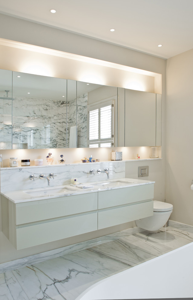 lights hidden behind mirrors is a must for bathrooms and powder rooms (Harriet Forde Design)