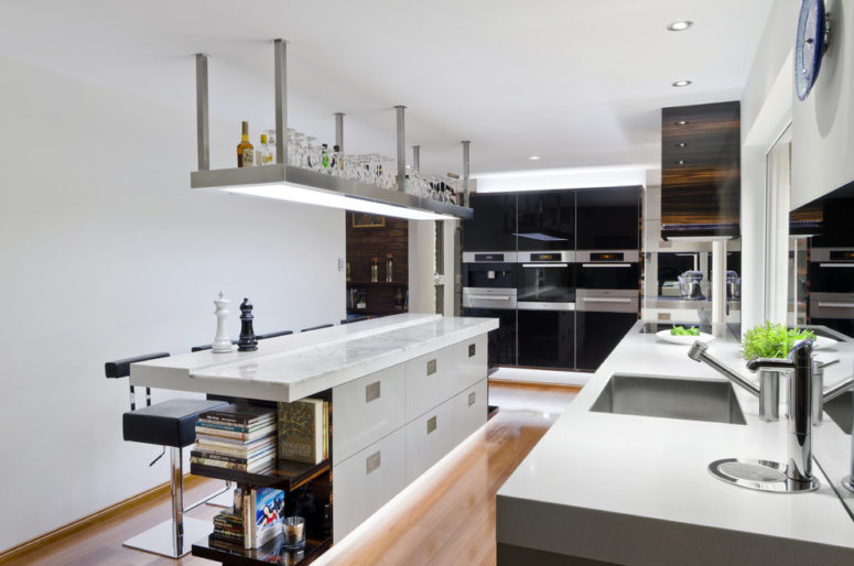 LED strip lighting under a kitchen island is a cool idea to make in a centrepiece of a kitchen (Darren James Interiors)