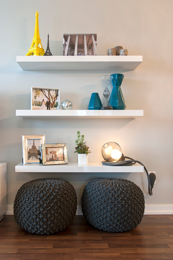 Display the stuff you bring from travels. Floating shelves provides lots of space to do that without looking too bulky. (Heather Merenda)