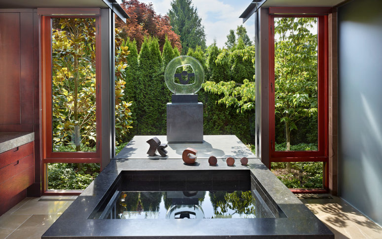 a sunken bath overlooking a stylish zen-garden makes this amazing bathroom a perfect room for relaxation (Garret Cord Werner Architects & Interior Designers)