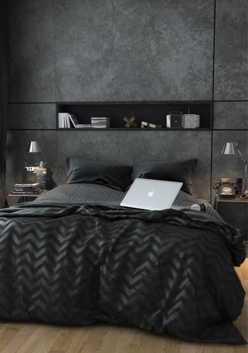 modern bedroom with a wall niche, mirror nighstands and cool black bedding