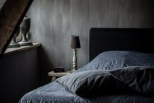 moody bedroom with textural walls and vintage finds from a flea market