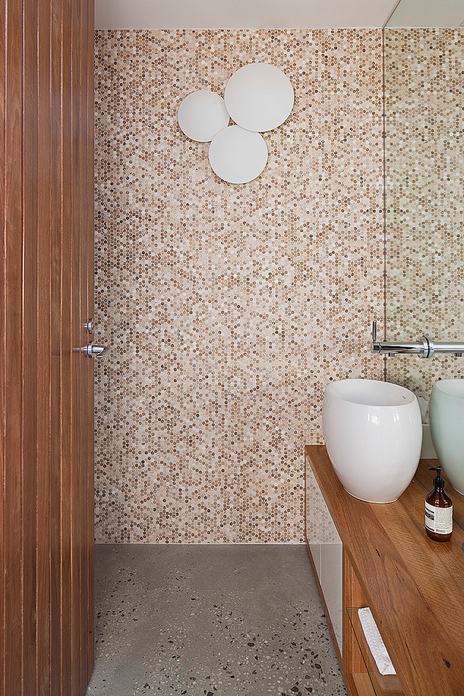 different shades of beige penny tiles looks beautiful on a shower's wall (bg architecture)