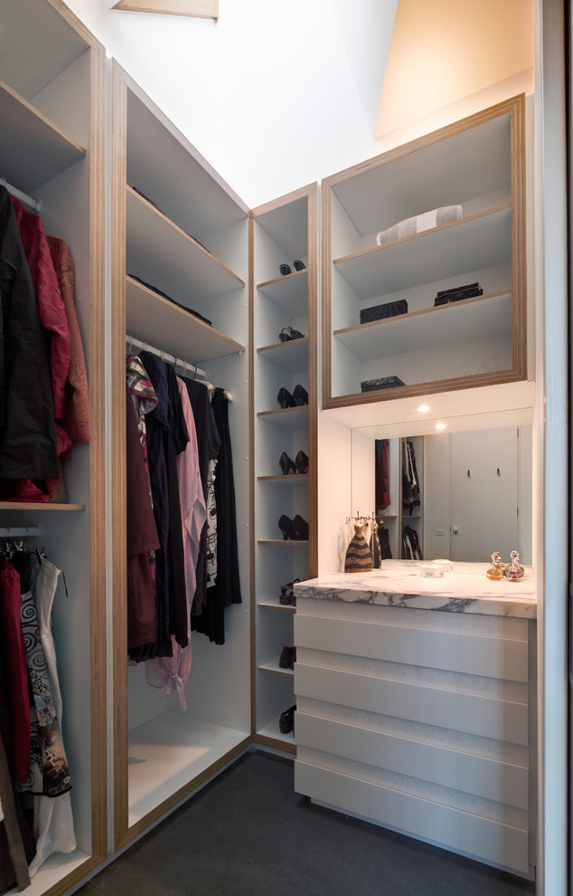even a small mirror is a great addition to a neatly organized closet (Mihaly Slocombe)