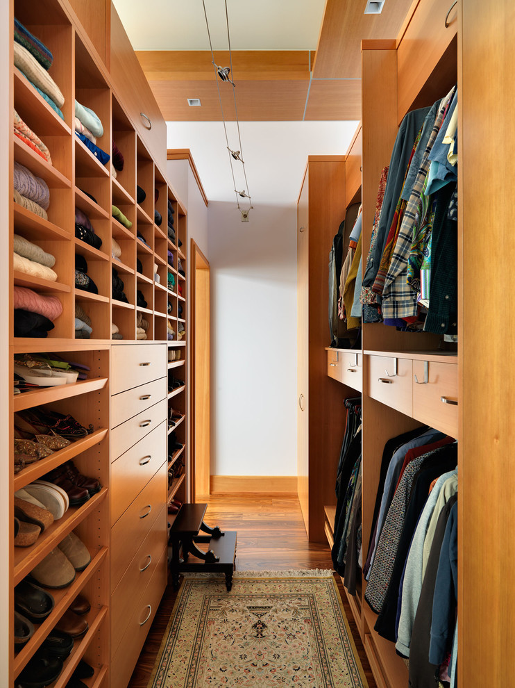 lots of drawers and sliding shelves are important for a narrow walk-in closet (Mike Knight Construction)