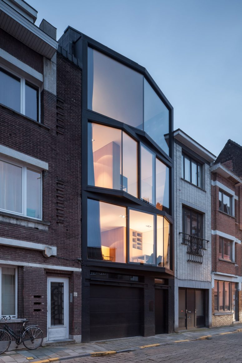 Abeel House was built on a narrow plot and its amazing feature is angled glazing frames