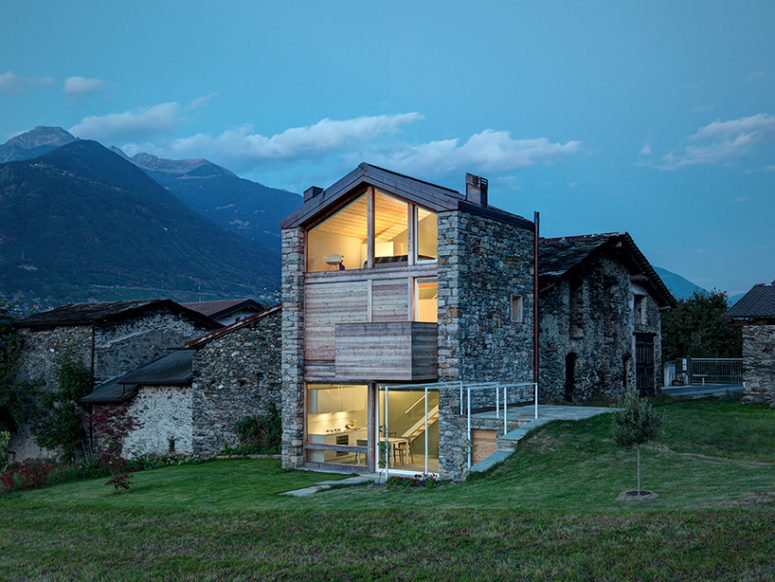 Modern Stone Cottage modern alpine house with an extensive use of timber and stone