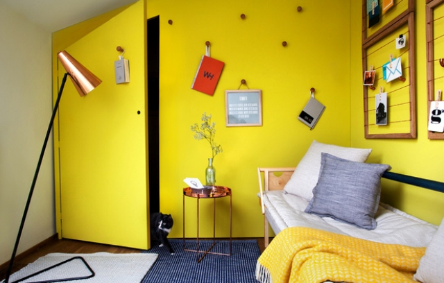 This small attic space was turned into a guest room and laundry and was decorated in sunny yellow for a cool ambience
