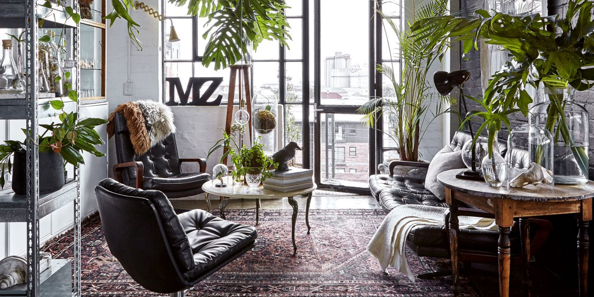 This unique loft seems to be taking us to the Victorian times wwith its antique fruniture, moody colors and faux taxidermy looking like natural