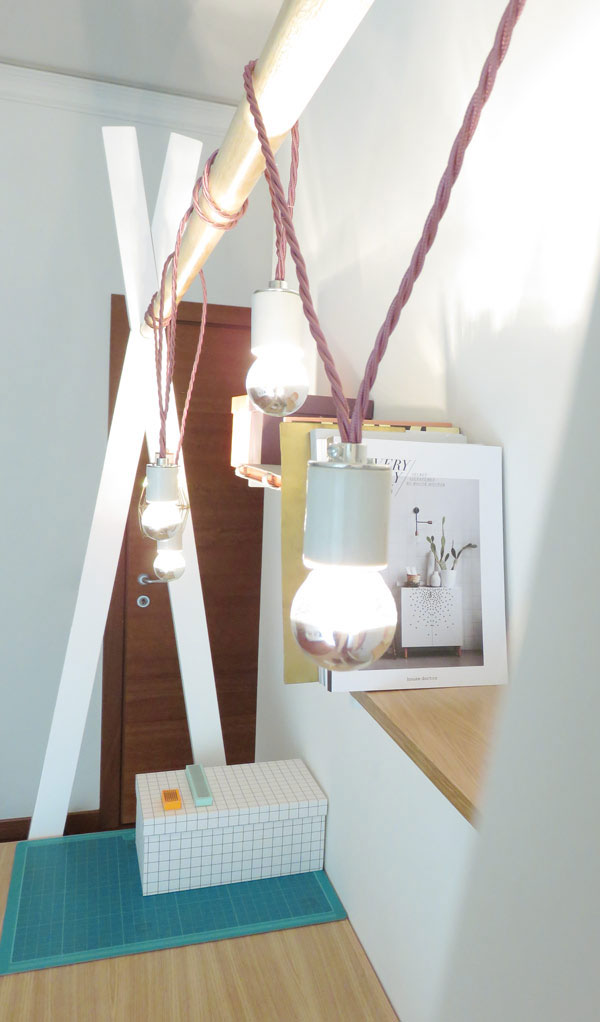The desk leaves floor space unused and you can hang various lights, shelves and planters on the holder