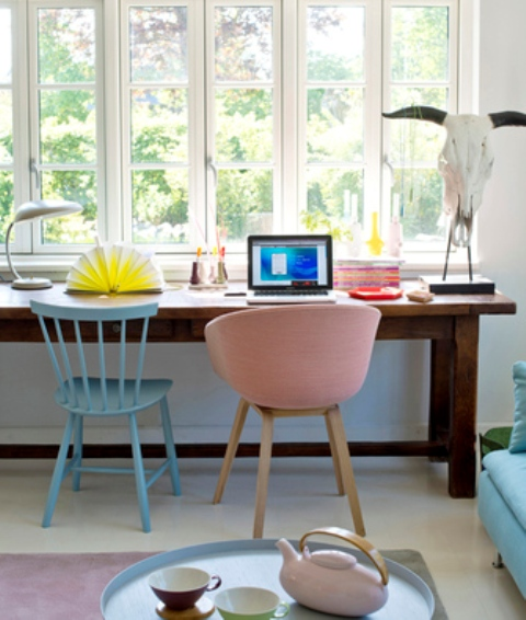 The furniture is mid-century modern and cute, it makes the home office welcoming