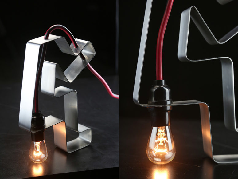 The piece is made of stainless steel and a red cord with a bulb, it features industrial design