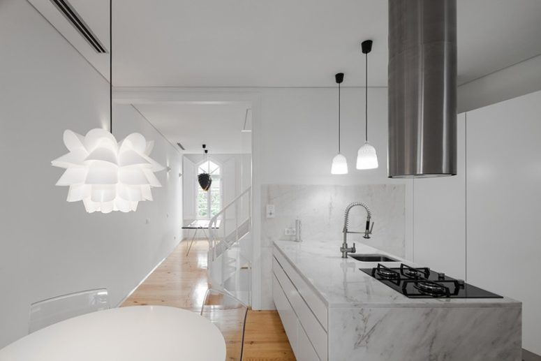 White color is methodically repeated on walls, ceilings, carpentry and marble to make the interiors modern and spacious