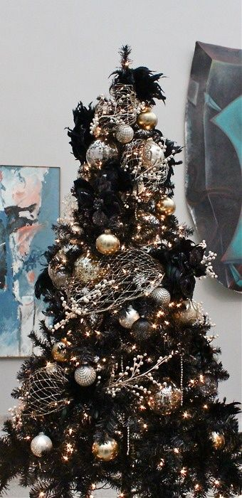a black Christmas tree decorated in gold and silver for a chic gothic-inspired look