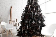 02 a black Christmas tree with white icicle and snowflake ornaments