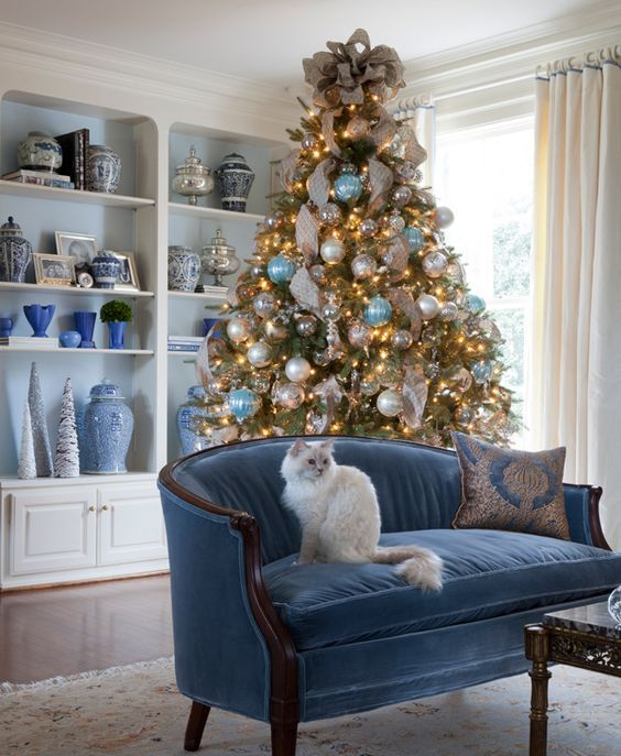 a blue, white and pearl Christmas tree decor looks very delicate