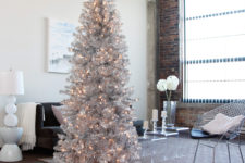 02 a tall shiny silver tree will perfecly fit a modern space, just add some lights for a sparkling look