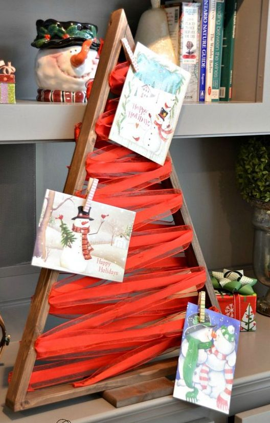 A Wooden Tree Frame With Ribbon For Hanging Cards