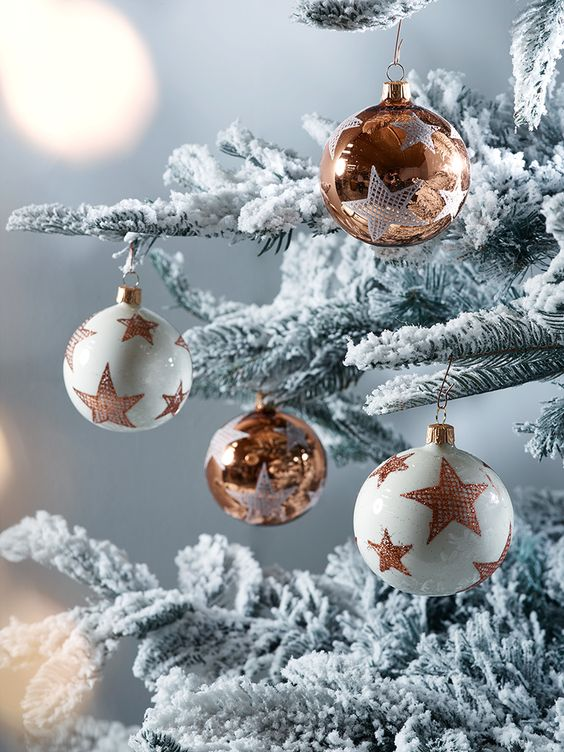 amazing ivory and copper star ornaments for decorating your tree