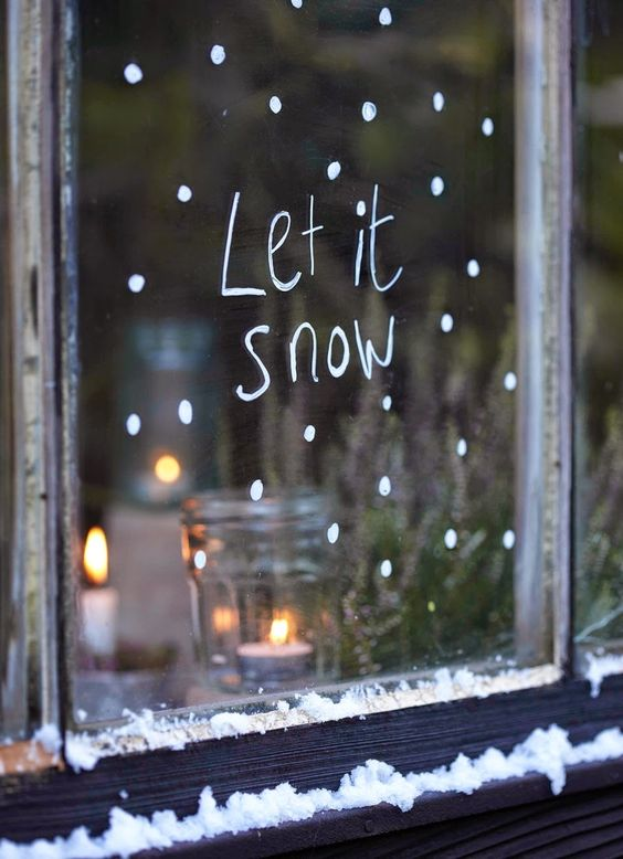 window decorated with white paint and words from a famous song