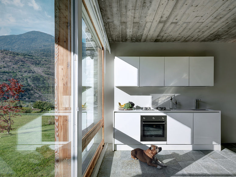 The interiors are modern, almost minimalist with rustic touches and they center around the views like this kitchen