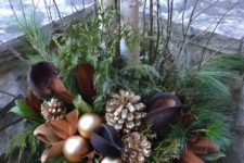 03 a chic brown and gold Christmas urn with leaves, ornaments and gilded pinecones