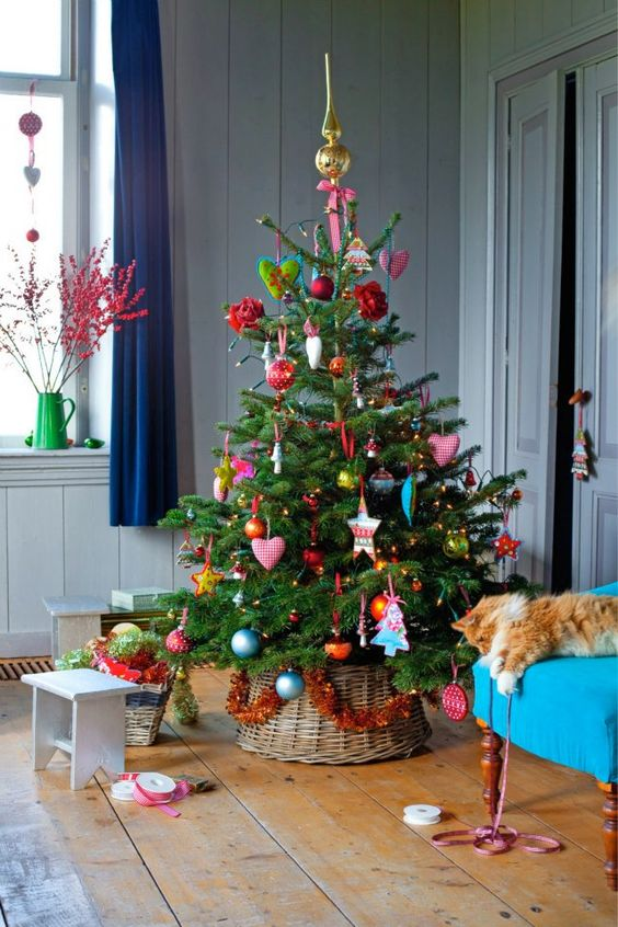 a colorful tree in a basket looks sweet and cozy