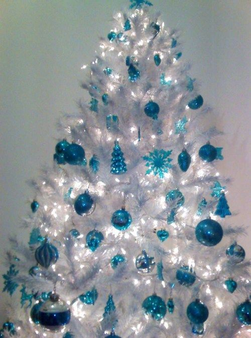a crispy white Christmas tree with blue ornaments