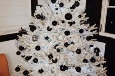 03 a crispy white tree with black matte and glossy ornaments