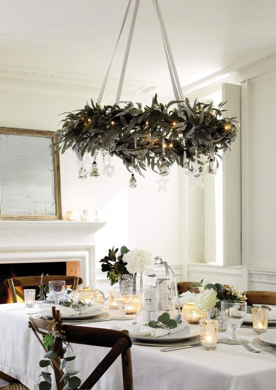a hanging wreath chandelier with silver ornaments and lights - How To Decorate A Chandelier For Christmas