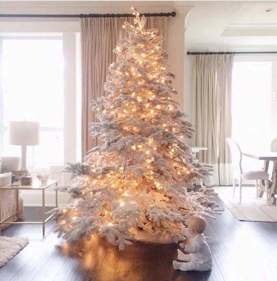 a large flocked tree with lights - you don't need any ornaments