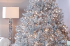 03 a large silver tree with lights will flatter a neutral or a pastel space fitting the look