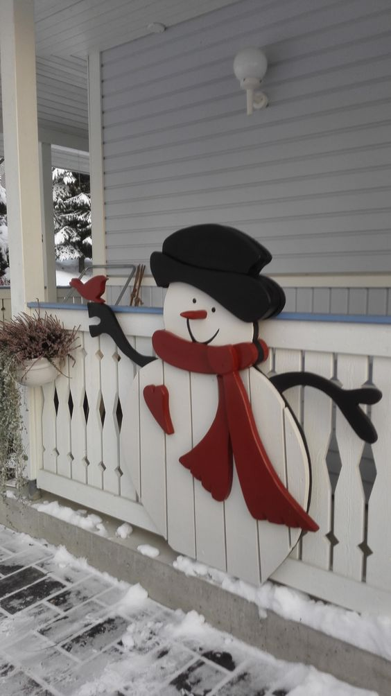 a snowman made of plywood and board can be a nice decoration for outdoors