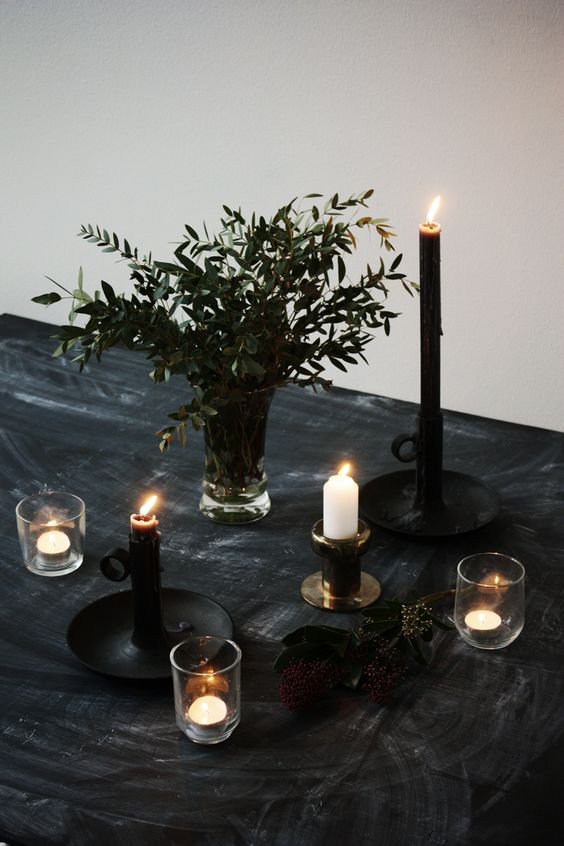 charcoal black tablecloth, greenery and candles