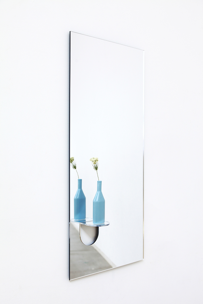 The cute flap extends up and out of the glass creating a little ledge in the face of mirror