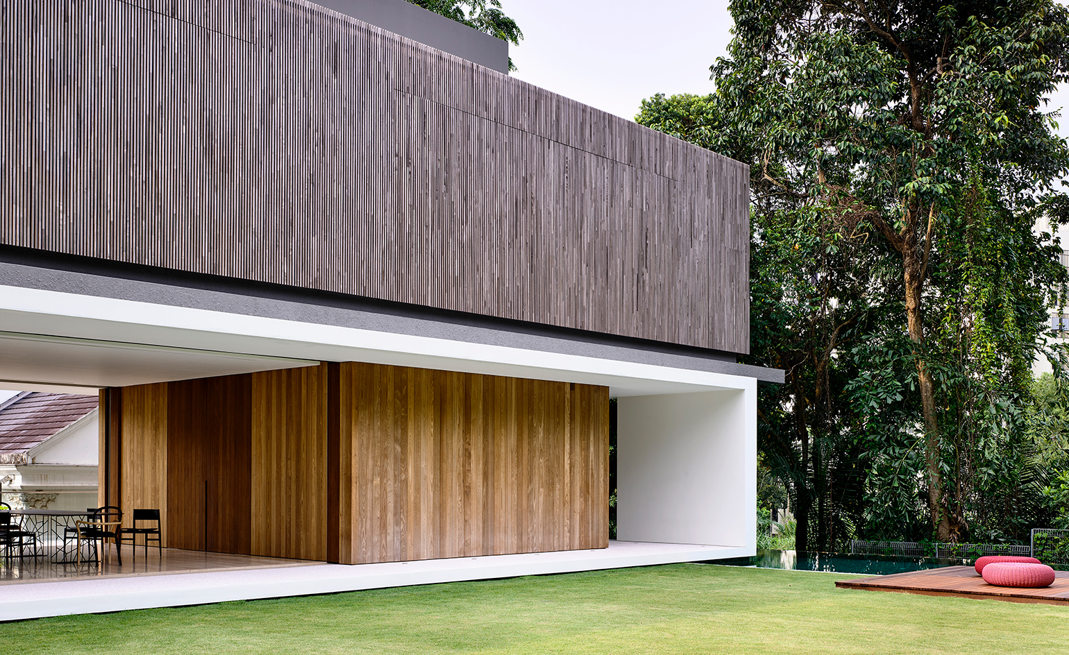The structure comprises three neatly stacked volumes of reinforced concrete and modern design